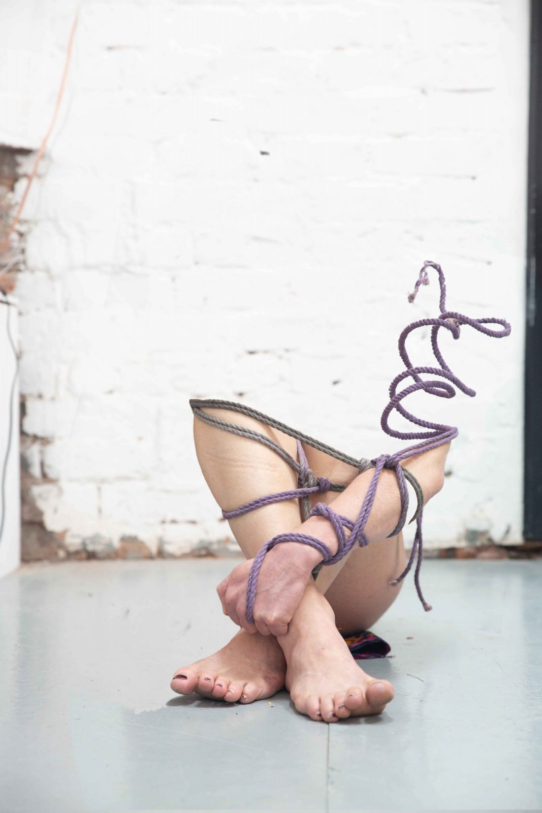 Woman's legs tangled in rope - Unseen by Suzie Larke