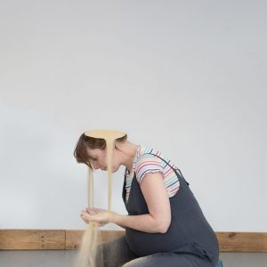 Woman catching sand from her head - Unseen by Suzie Larke
